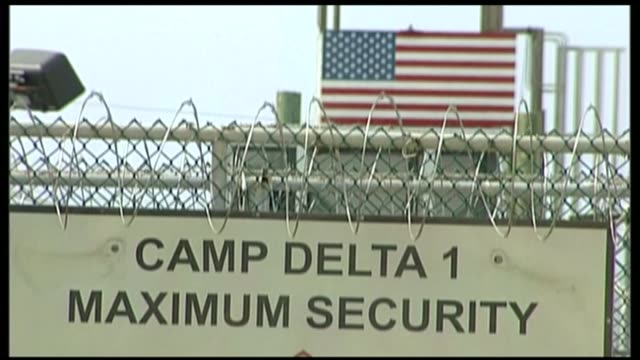 concern for health of guantanamo bay prisoner shaker aamer r12090610 / 1292006 guantanamo bay naval base camp delta ext us flag seen through rolls of... - shaker aamer stock videos & royalty-free footage