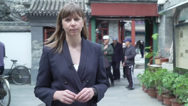 concern for muslims detained in 'concentration camps'; china: beijing: niu jie mosque: ext worshippers along in grounds of niu jie mosque entrance to... - kazakhstan stock videos & royalty-free footage