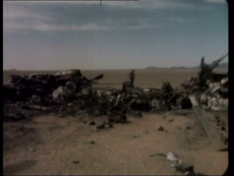 concern grows over iran's nuclear ambitions american helicopters lying in the desert after failing to rescue the hostages from the american embassy... - 人質点の映像素材/bロール