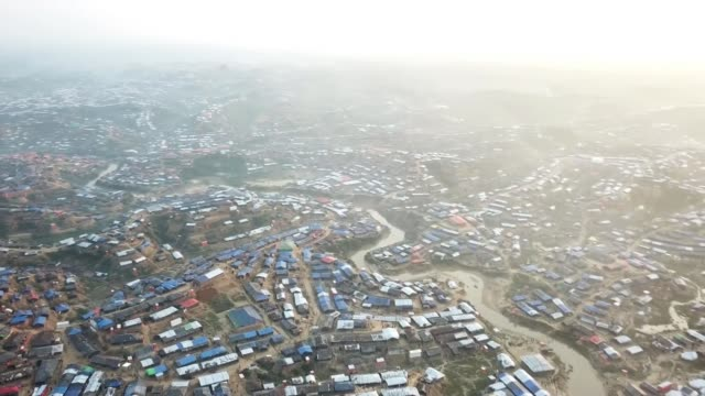 concern over bangladesh plans to repatriate rohingya refugees date refuges along through camp drone footage of refugee camp woman holding baby... - rohingya kultur stock-videos und b-roll-filmmaterial