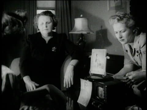 concerned families listen to news about the war on radios during world war ii - radio stock videos & royalty-free footage