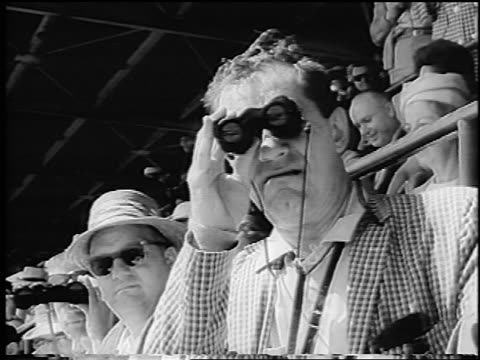 b/w 1966 concerned male spectator with binoculars at indianapolis 500 after crashes / newsreel - cinematografi bildbanksvideor och videomaterial från bakom kulisserna