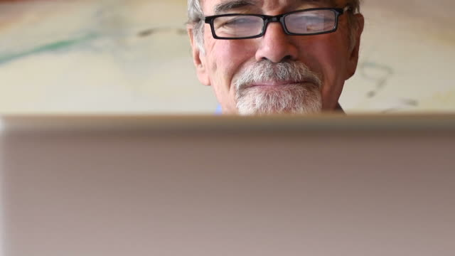 Concerned Senior Man with Computer