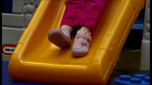 concerns over nursery staff literacy skills int anonymous shots of children playing in nursery school - キャシー・ニューマン点の映像素材/bロール