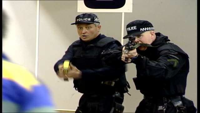concerns over use of taser guns; tx 17.4.2003 northamptonshire: int various shots of police officers carrying out taser stun gun training - northamptonshire stock-videos und b-roll-filmmaterial