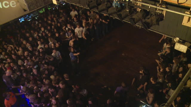 SLO MO WS HA Concert audience parting and getting ready for 'wall of death' at popular hard rock concert / London, United Kingdom