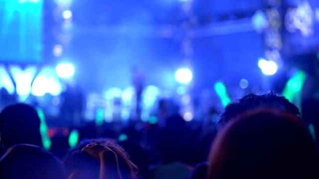 MS Concert crowd dance at the night concert. Defocused shot