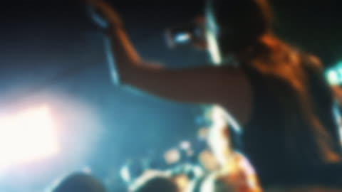 concert crowd defocused. - obscured face stock videos & royalty-free footage