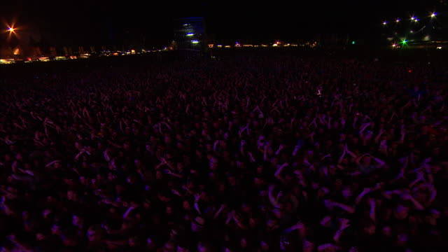 w/s ext concert crowd festival night lights - festival goer stock videos & royalty-free footage