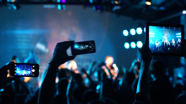 concert crowd filming with smartphone - concert stock videos & royalty-free footage