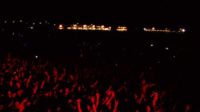 w/s ext concert crowd night - festival goer stock videos & royalty-free footage