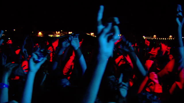 w/s ext concert crowd night - rocking stock videos & royalty-free footage