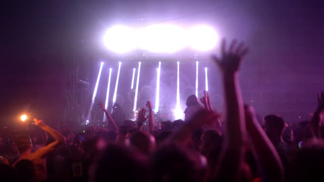 concert crowd partying, 4k. - behind stock videos & royalty-free footage
