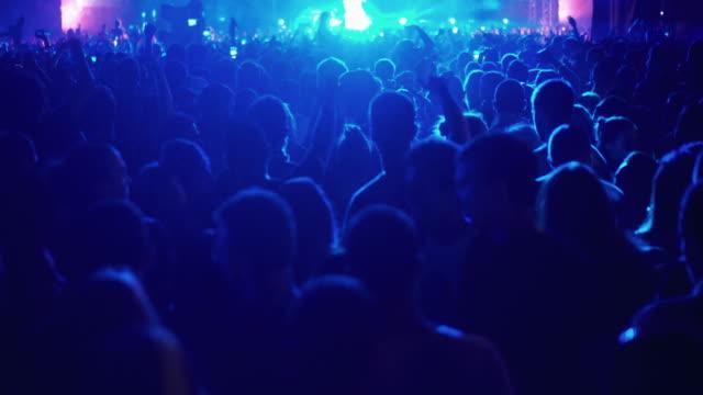 concert crowd,4k - behind stock videos & royalty-free footage