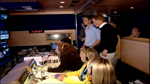 final preparations; int prince william and prince harry watching concert broadcast rehearsal in television control room, directors tells princes... - probe stock-videos und b-roll-filmmaterial