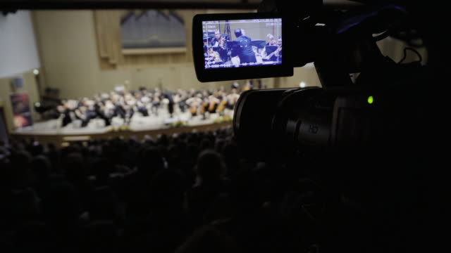 concert of classical music, the camcorder records the action from the back row. - 独奏者点の映像素材/bロール