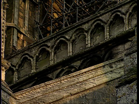 concert to raise money for salisbury cathedral spire itn wiltshire salisbury cathedral seq damaged sections of cathedral / scaffolding seq workmen... - spire stock videos & royalty-free footage