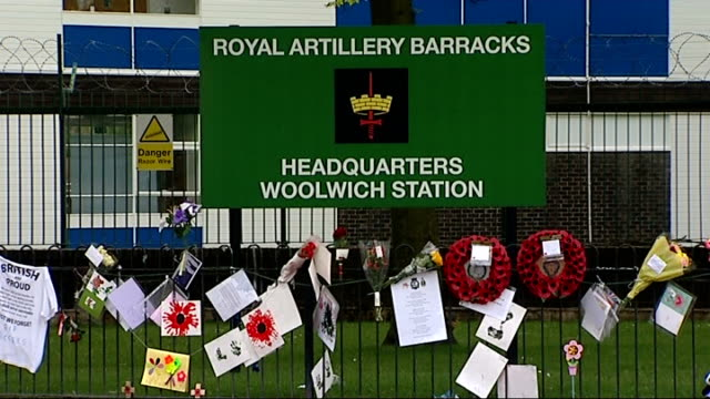 concert to remember drummer lee rigby r31051306 / sign reading 'royal artillery barracks headquarters woolwich station' / blue helium balloon and... - helium stock videos & royalty-free footage