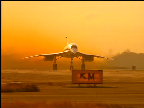 orange pan concorde airliner taking off from runway - british aerospace concorde stock videos and b-roll footage