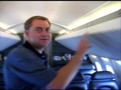 concorde: getting into aircraft seat - british aerospace concorde stock videos and b-roll footage