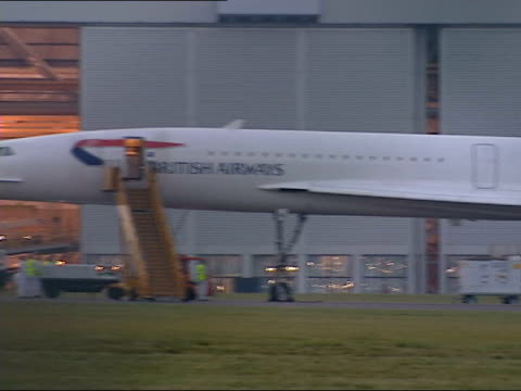 concorde makes emergency landing lunchtime cardiff cardiff airport british airways concorde on tarmac outside hangar pan ms side cockpit of concorde... - british aerospace concorde stock videos and b-roll footage