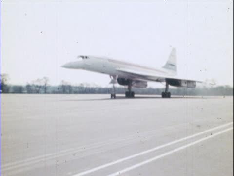 concorde taxis along runway during its maiden flight man walks into shot fairford raf station 09 apr 69 - british aerospace concorde stock videos & royalty-free footage
