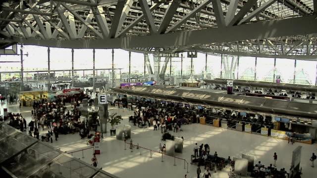 WS Concourse between terminal and boarding gates at Suvarnabhumi airport / Bangkok, Thailand