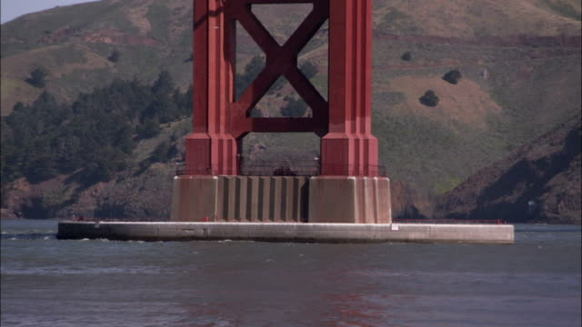 a concrete base stabilizes one of the massive towers of the golden gate bridge. available in hd. - golden gate bridge stock-videos und b-roll-filmmaterial