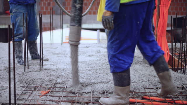 ld concrete being poured onto the rebar layout for the floor of the building - boot stock videos & royalty-free footage