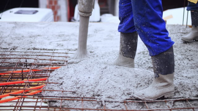 concrete being poured onto the rebar structure - concrete stock videos & royalty-free footage