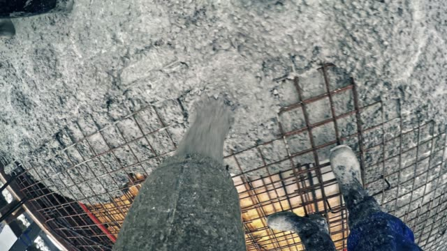 pov concrete being poured onto the steel reinforcement - concrete stock videos & royalty-free footage