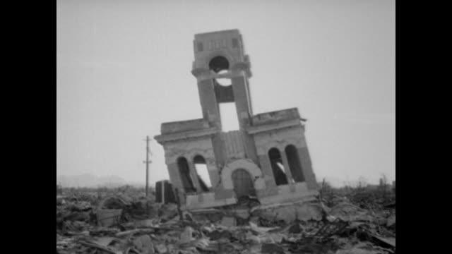 vídeos y material grabado en eventos de stock de concrete buildings in hiroshima show the impact of atomic bomb - hiroshima prefecture
