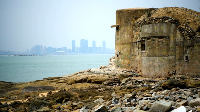 concrete bunker overlooks the chinese city of xamen from the taiwanese island of little kinmen which, at points lies only a few miles from china, on... - bunker struttura creata dall'uomo video stock e b–roll