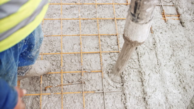 concrete flowing out of the hose - concrete stock videos & royalty-free footage