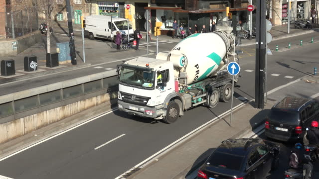 concrete mixer truck driving during the low emission zone on december 31 2019 in barcelona spain on january 2 the low emission zone will be... - cement mixer stock videos & royalty-free footage