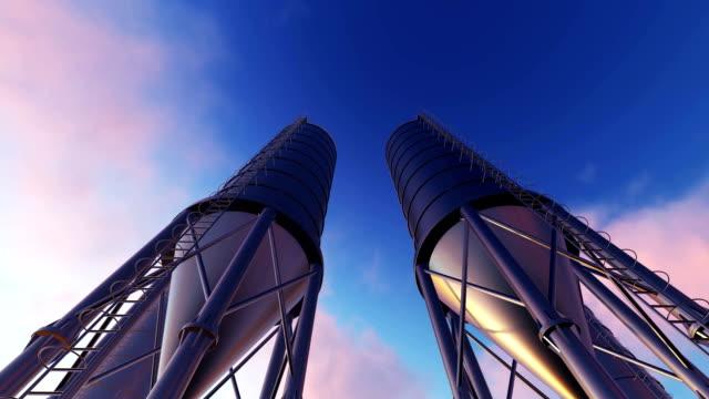 vídeos de stock, filmes e b-roll de torres de mistura concreta - concreto