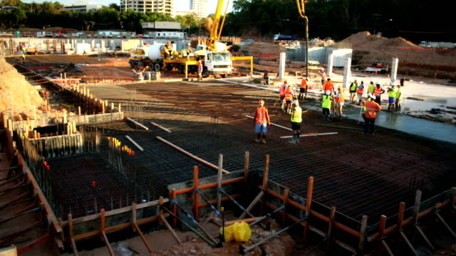concrete pour (construction) - construction site stock videos & royalty-free footage
