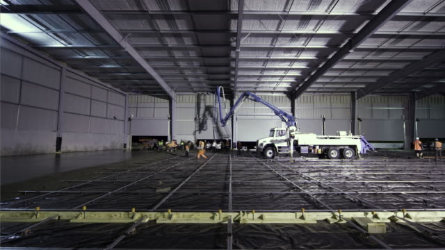 T/L, WS, Concrete slab being poured for warehouse floor, Highbrook, Auckland, New Zealand