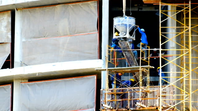 concrete slab, construction workers work on building - scaffolding stock videos & royalty-free footage