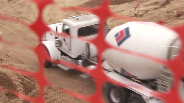 a concrete truck drives on a pour site. - cement mixer stock videos & royalty-free footage