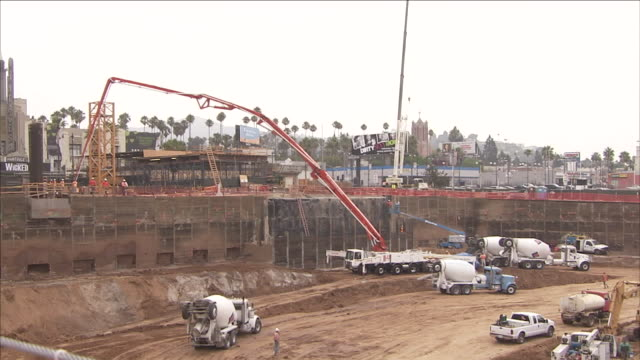 concrete trucks drive on a construction site. - cement mixer stock videos & royalty-free footage