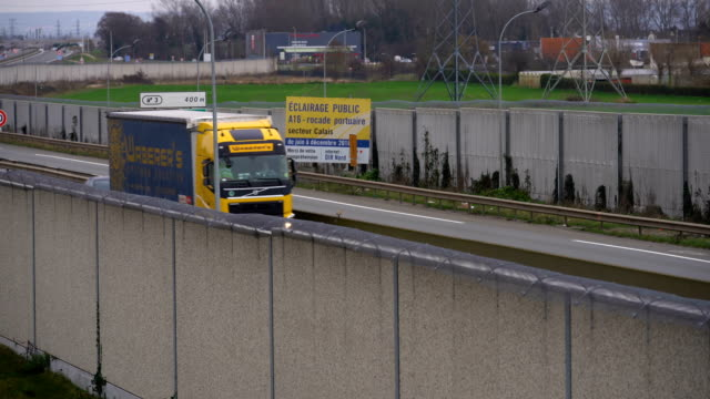 a concrete wall secures the main motorway into calais port to prevent migrants climbing on trucks on january 07 2019 in calais france in recent weeks... - calais stock videos & royalty-free footage