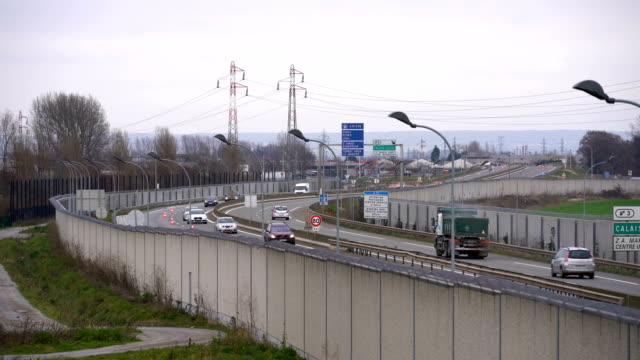 A concrete wall secures the main motorway into Calais Port to prevent migrants climbing on trucks on January 07 2019 in Calais France In recent weeks...