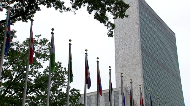 vídeos de stock, filmes e b-roll de un condemns donald trump's decision to recognise jerusalem as israel's capital usa new york united nations ext row of international flags outside... - united nations