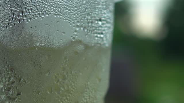condensate on glass sliding shot - fizzy lemonade stock videos & royalty-free footage
