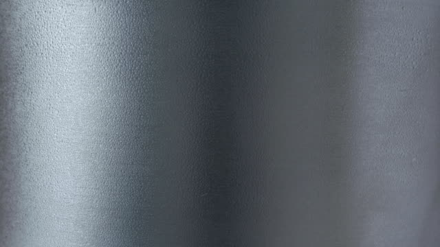 condensation on a stainless steel mug. condensation occurs when water vapour in the air hits the cold surface and turns to liquid - condensation stock videos and b-roll footage