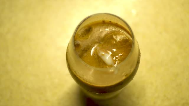 condensed sweetened milk into chocolate ice cream coffee - chocolate milk stock videos & royalty-free footage