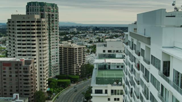condo towers looking down on los angeles - aerial view - westwood neighborhood los angeles stock videos & royalty-free footage