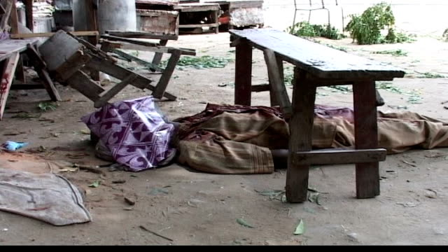 condoleezza rice calls for more peacekeeping troops man lying dead underneath bench body lying dead in midst of sound of gun battle sot - 平和維持点の映像素材/bロール