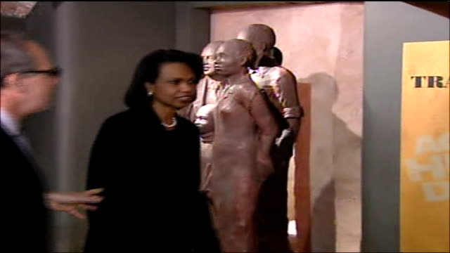 condoleezza rice lancashire visit: protests continue; liverpool: rice looking at exhibits in museum of transatlantic slavery then along chatting to... - loyd grossman stock videos & royalty-free footage